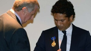 Sachin Tendulkar being invested with the regalia of an honorary Officer of the Order of Australia.  Image SMH